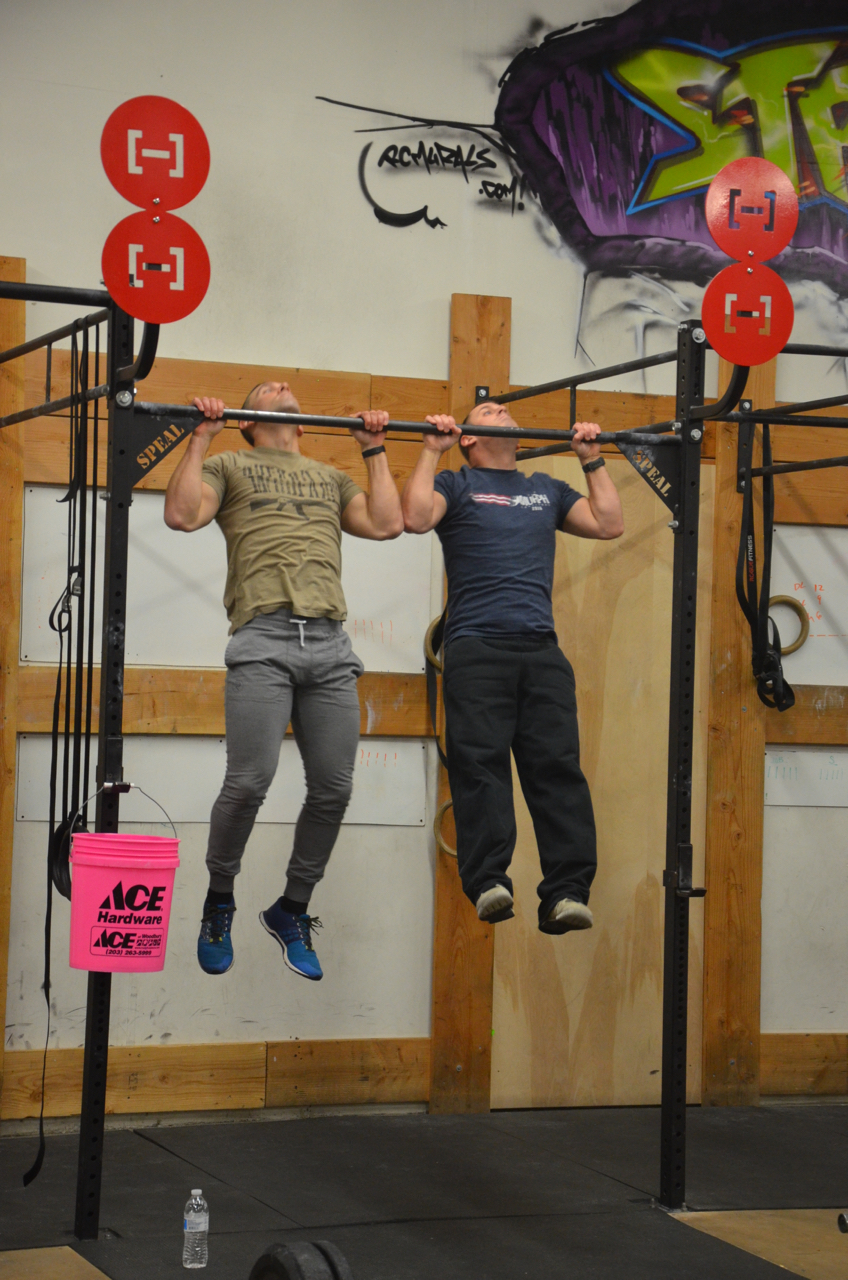 Kevan & Garrett during their strict burpee pull-ups