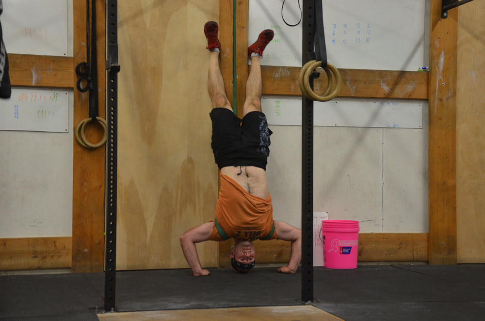 Jimmy getting a little bit of banded assistance on his handstand push-ups.