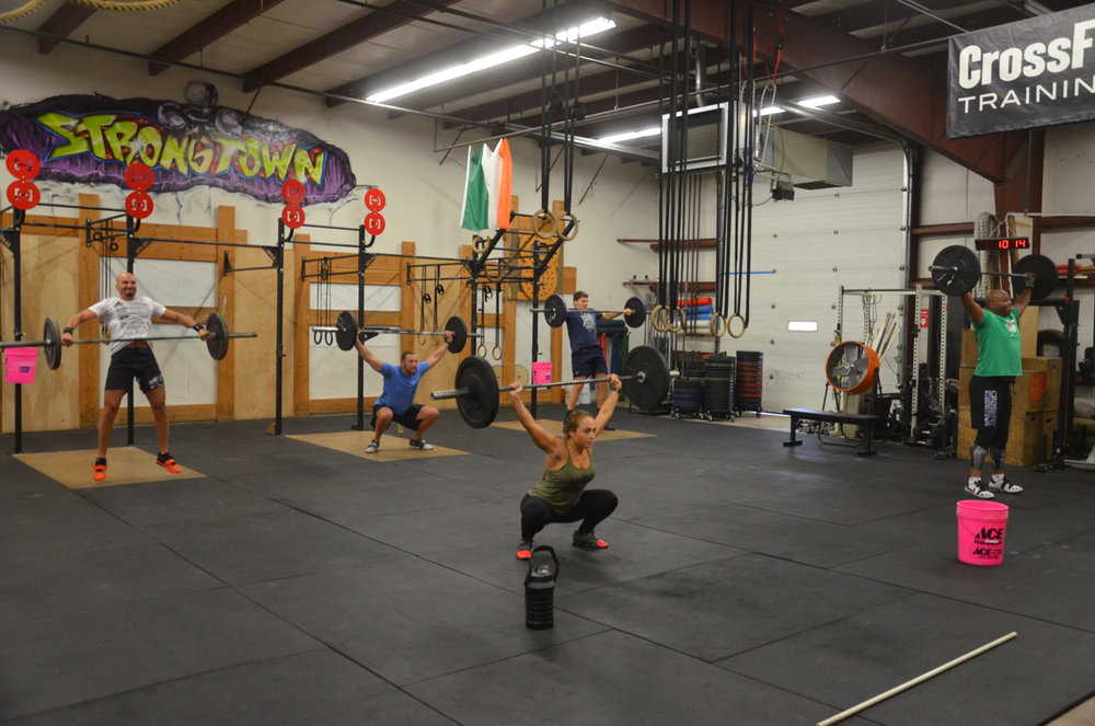 Cardella and the 9:30 working through their minute of hang squat snatches.
