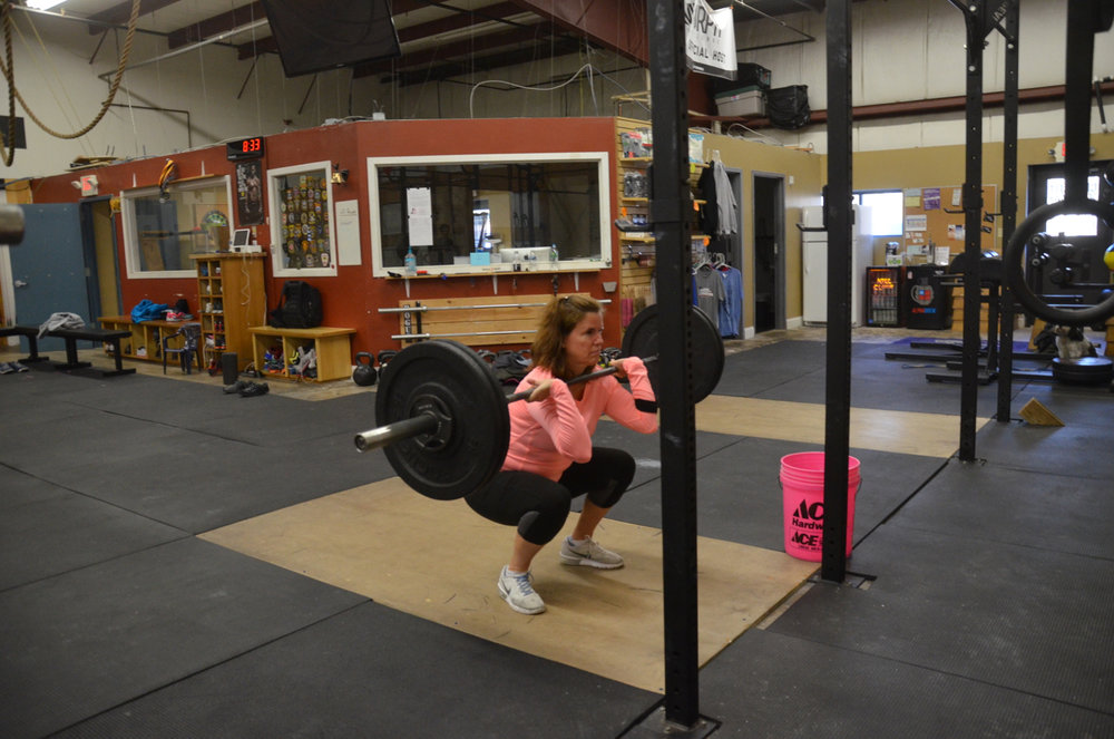 Susie getting deep in her front squats.