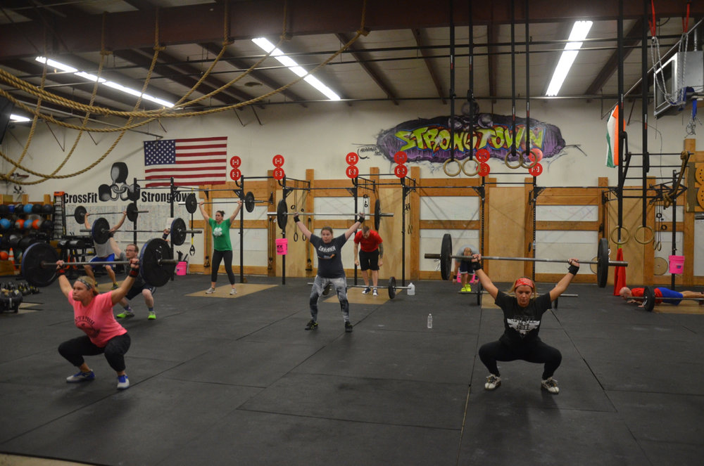 Friday's 4:00 class during their overhead squat & hand release push-up couplet.