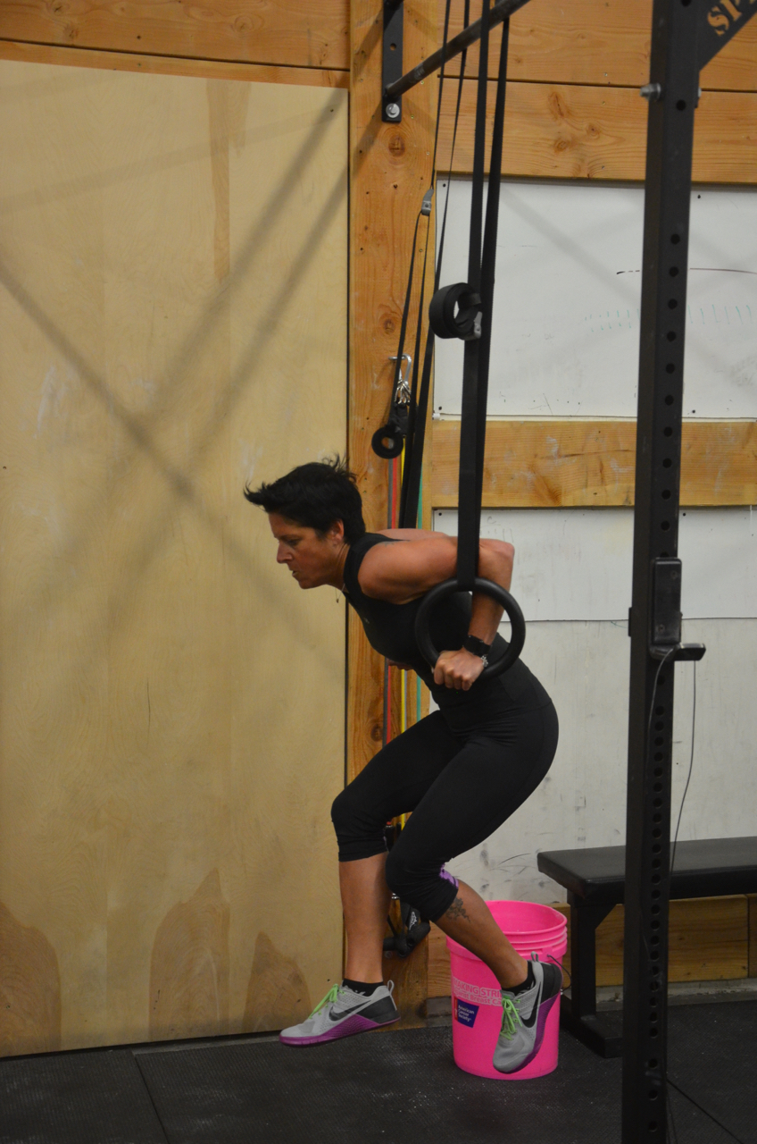 Tammy fighting through her ring dips.