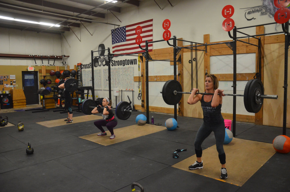 Ang, Kelly, and Sophia working through their front squats.