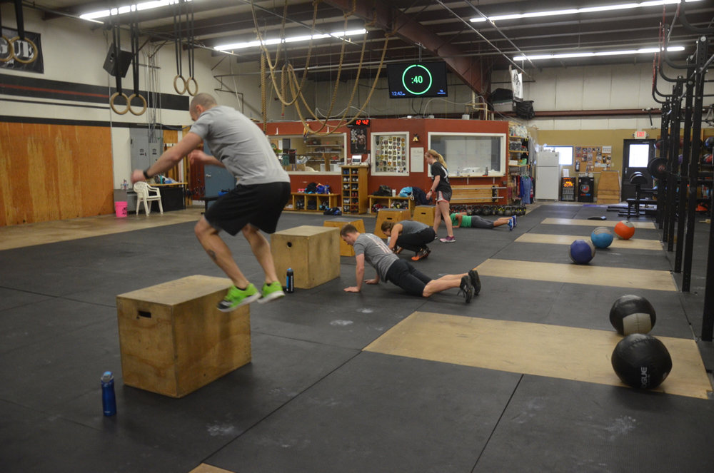 Lou and the 9:30 class working through their burpee box jumps.