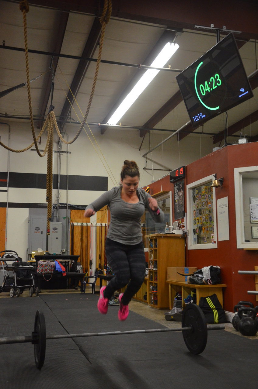 Tiff aka Mrs. War showing some hang time on her bar facing burpees.