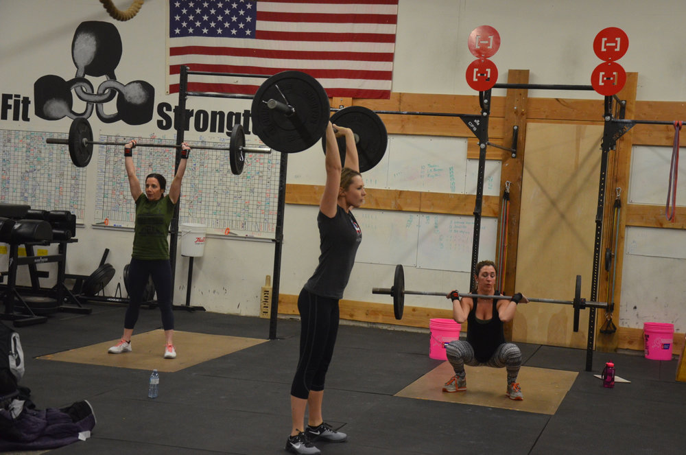 Cortney, Holly, and Lindsey looking strong on their thrusters.