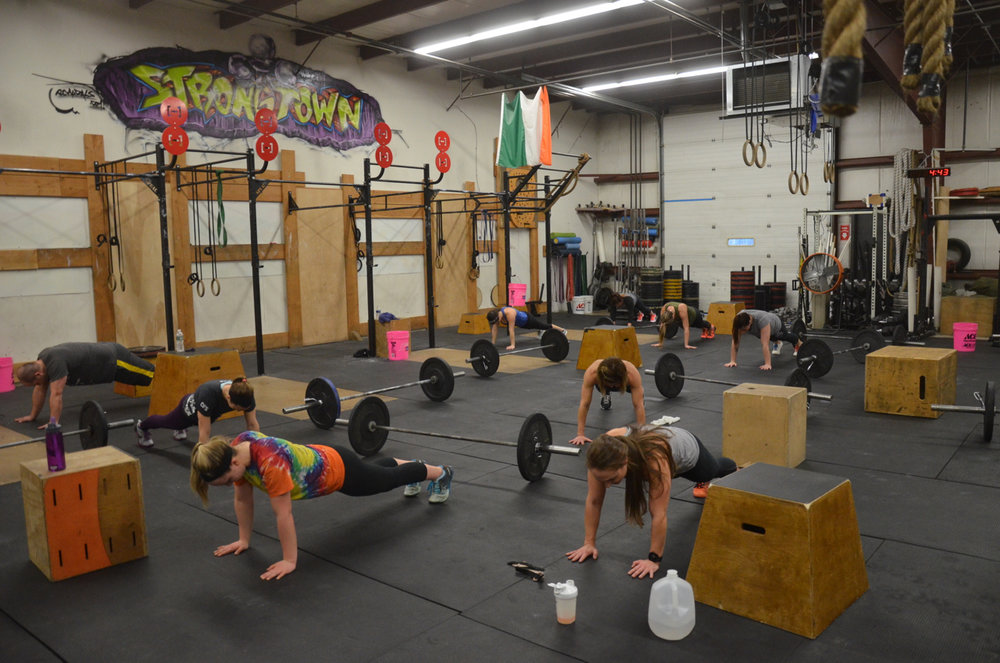 The 4pm class holding steady on their planks.