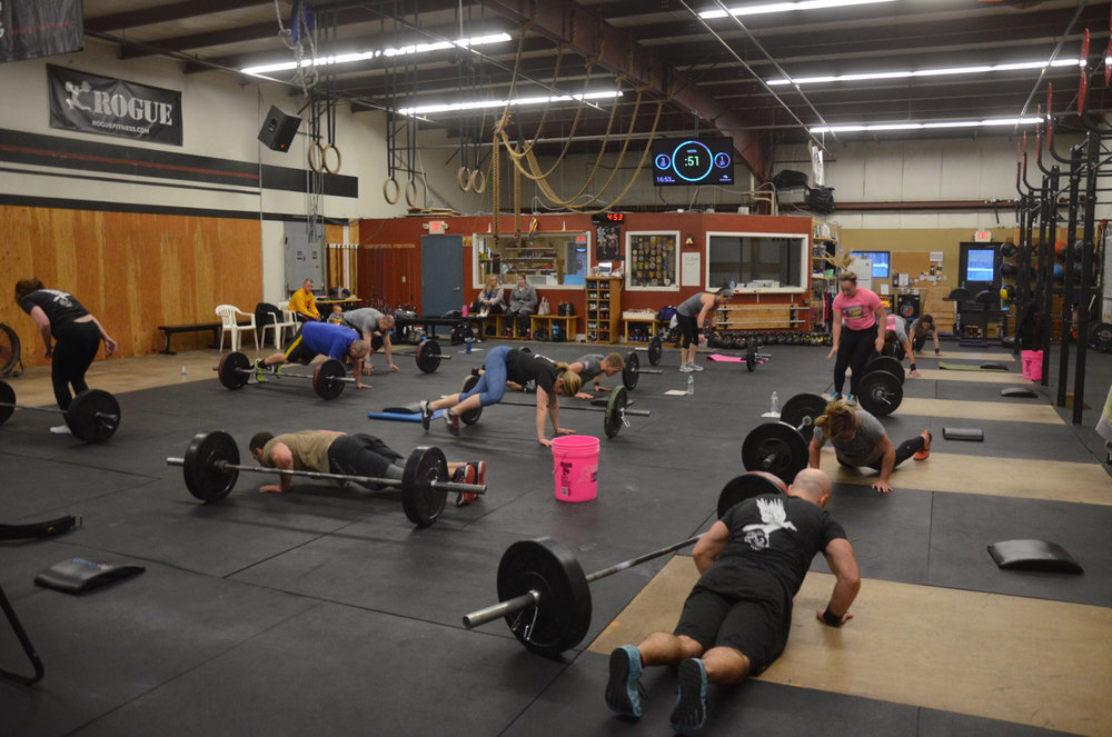 The 4pm class working through their lateral bar burpees.