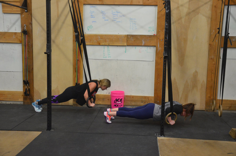 Sarah and Tots looking strong on their ring push-ups.