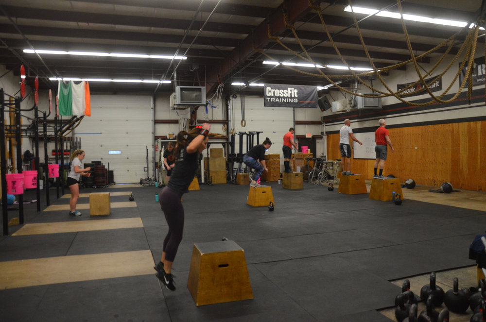Holly and the 9:30 class working through their box-jumps.