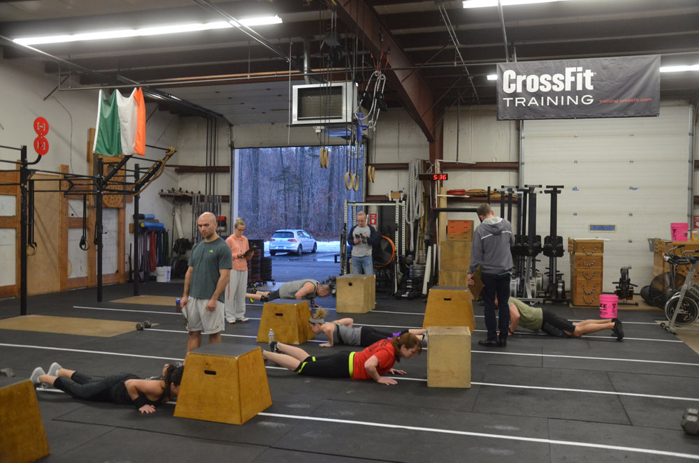 Friday night's 5:30 group working through their 15 burpee box jump overs.