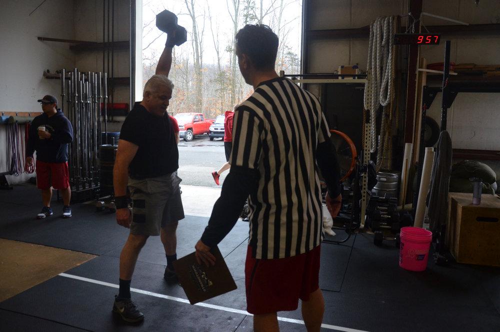 Carl making easy work of the 50# dumbbell.