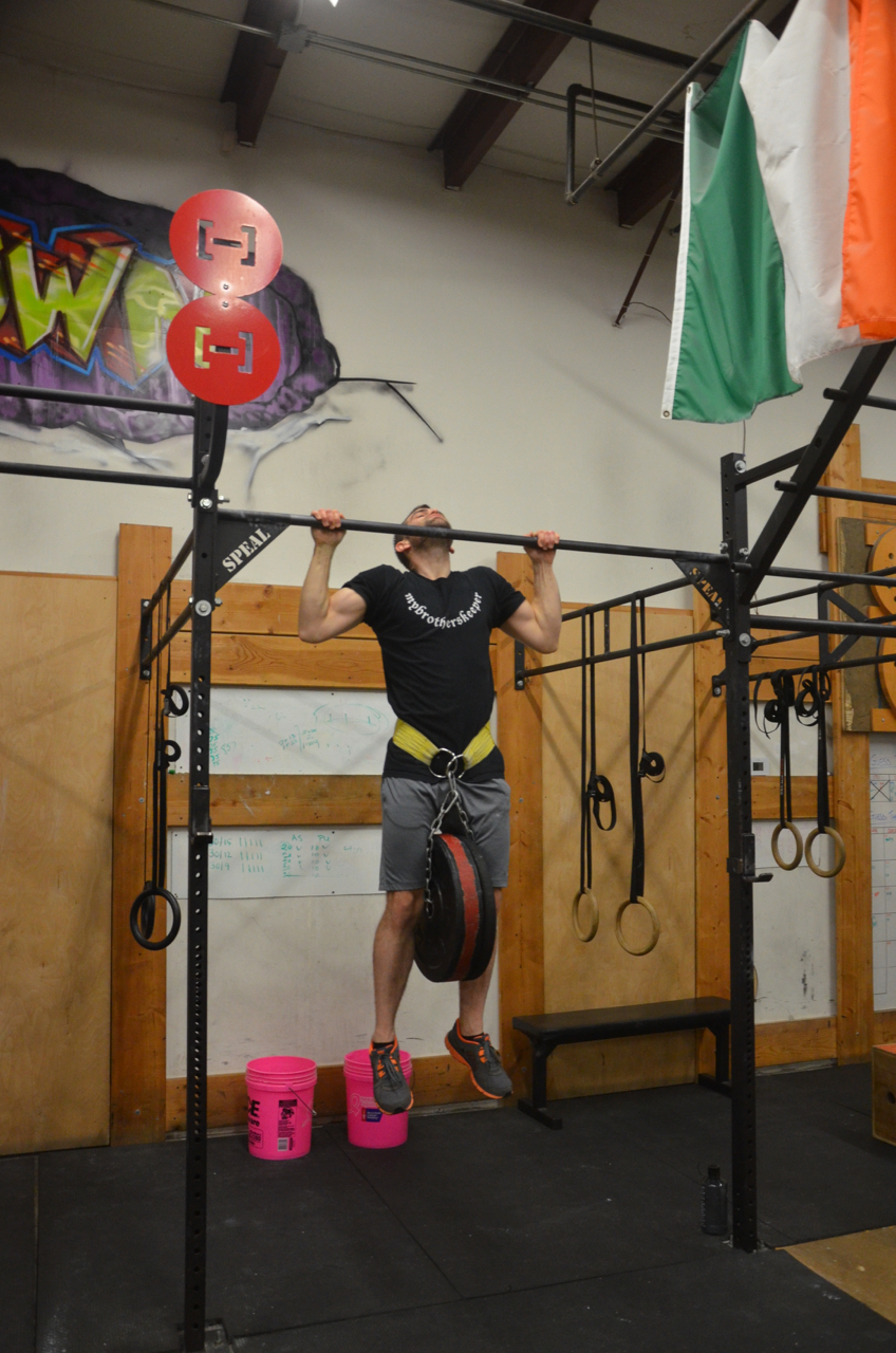 Jason taking 55 lbs for a ride on the pull-up bar.