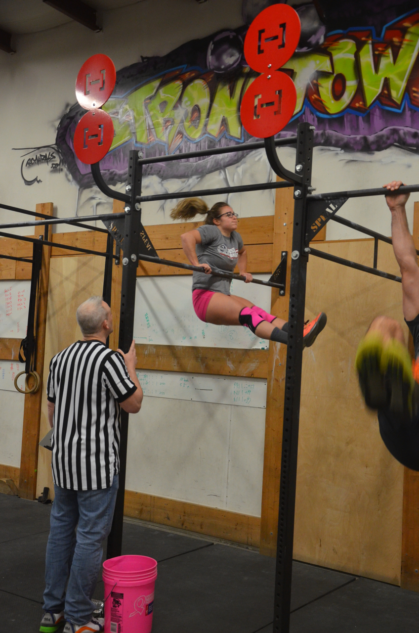Jordan finishing up her final bar muscle-ups.