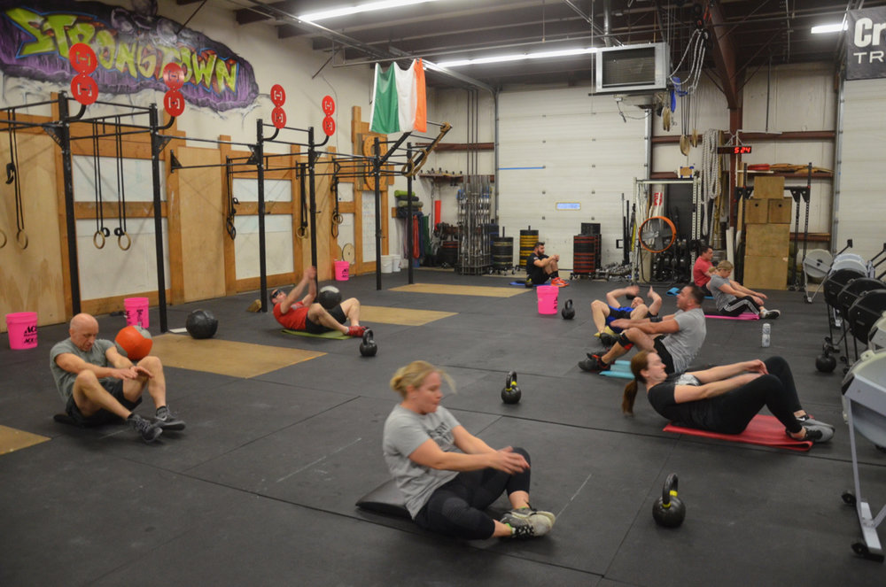 The 5pm class working through their 100 sit-ups.