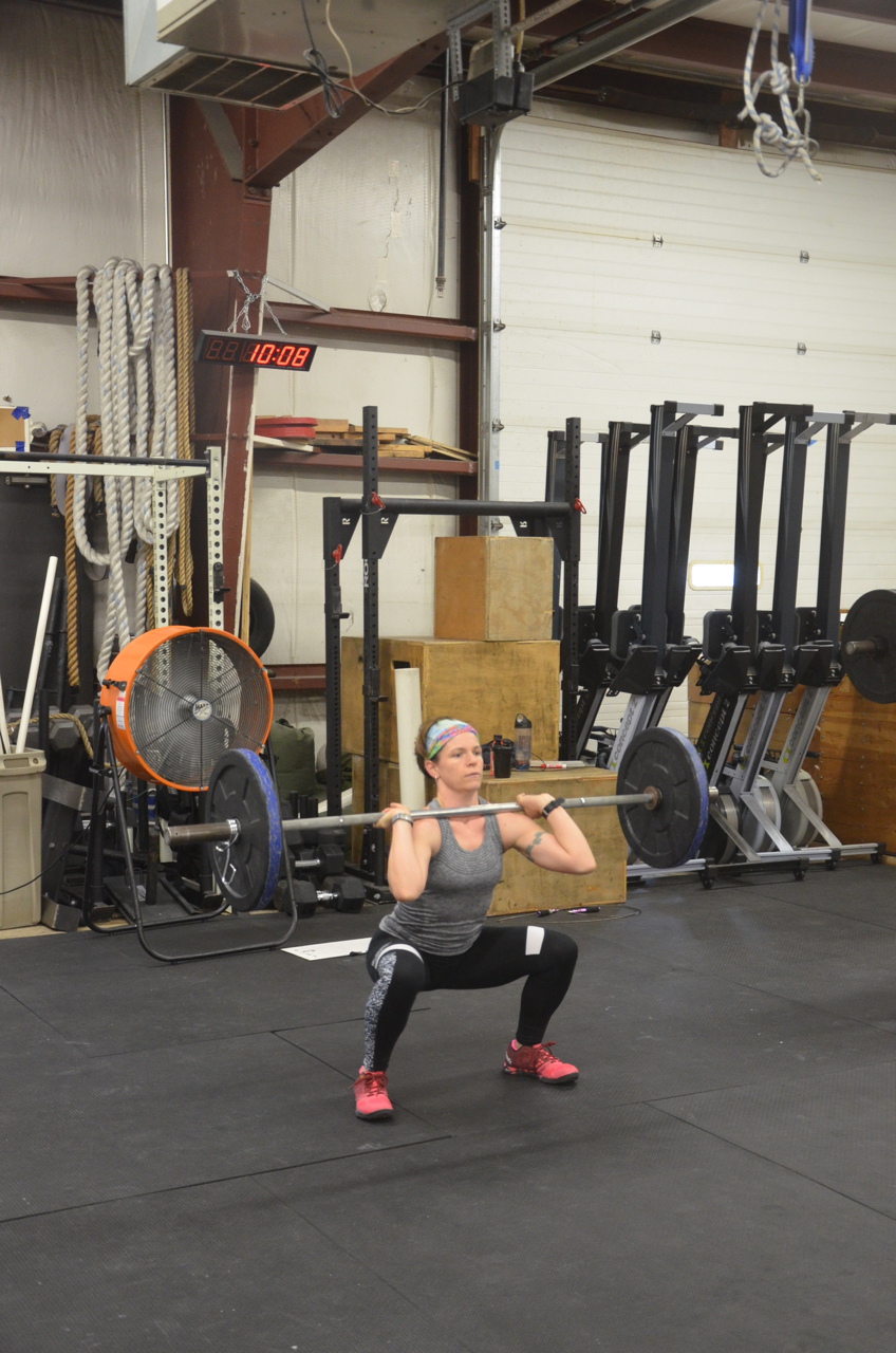 Jane getting deep in her front squats.