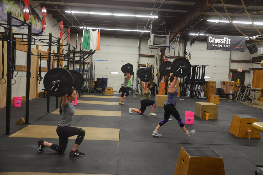 Holly and the 4pm class starting their 50 overhead lunges.
