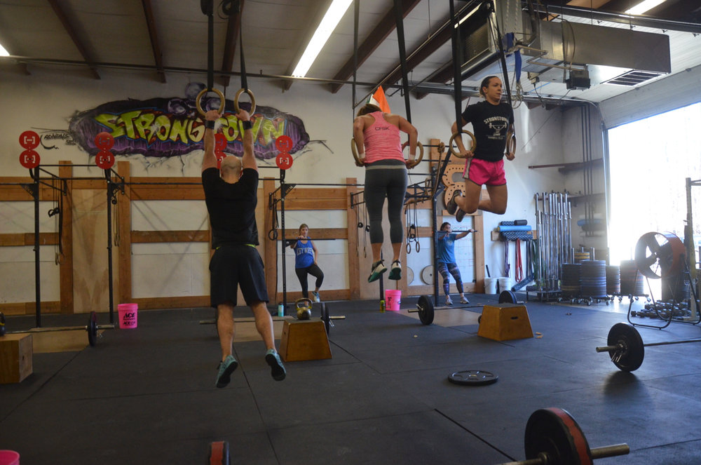 Timmy, Ang, and Kelly taking on their minute of muscle-ups during the 4pm class.
