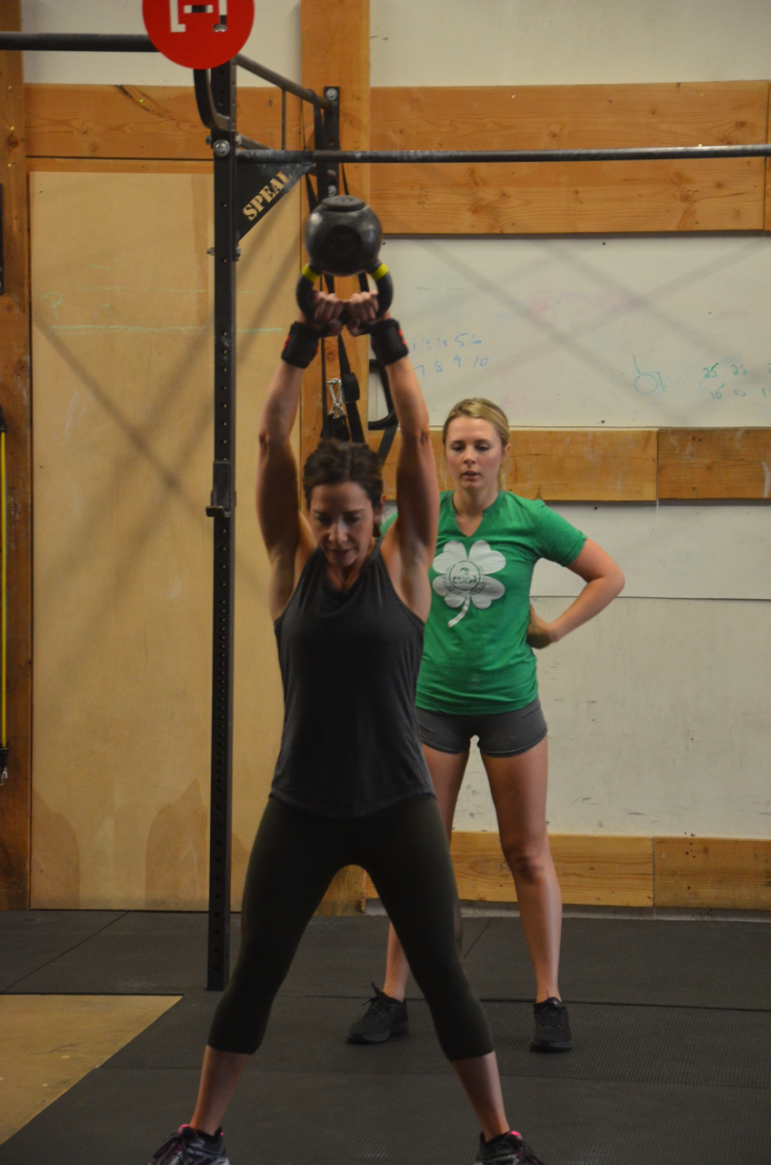 Holly and Cort working through their kettlebell swings during Sunday's Suck Fest.