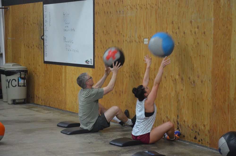 Dave & Kim finishing up their wall ball sit-ups.