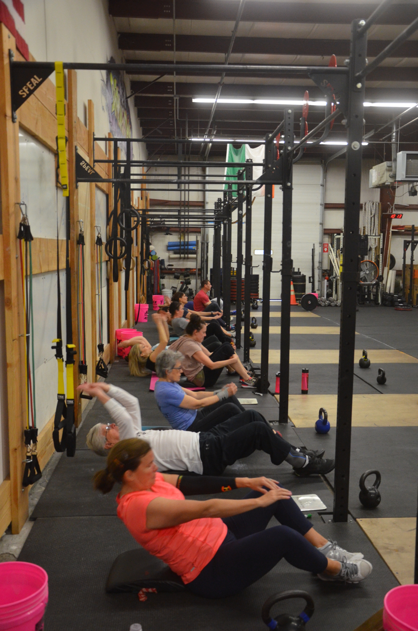 The 9:30 class working through their sit-ups.