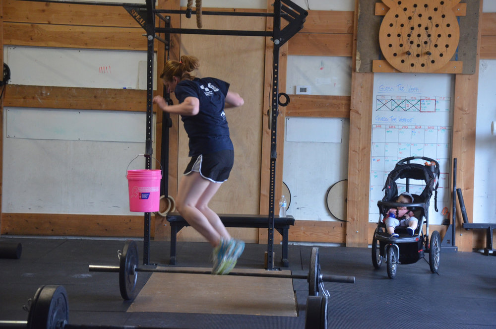 Becky flying through her lateral bar burpees.