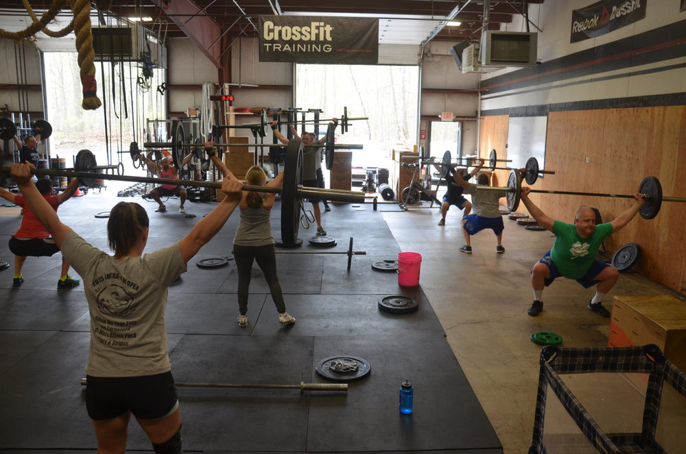 Saturday's 9am class starting their overhead squat & ring dip couplet.
