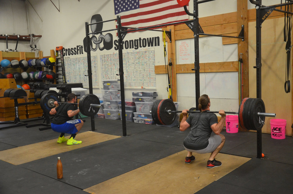 Dave and Seth getting deep in their back squats.