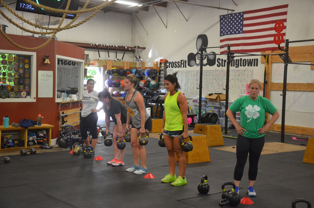 The 5pm ladies working through their kettlebell deadlifts.