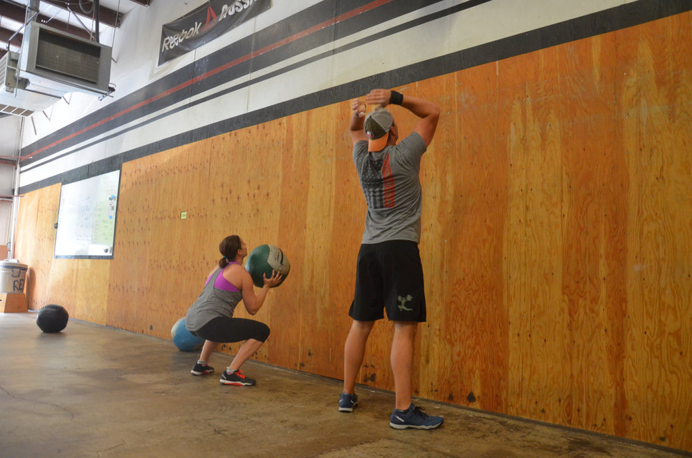 The Babington's during Saturday's power snatch & wall-ball ladder.