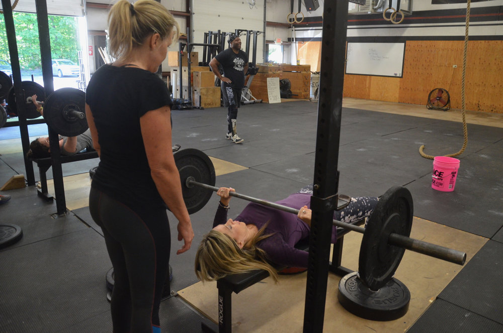 Kristie spotting Olga on her Bench Press.