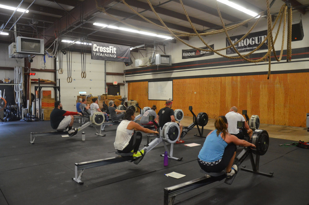 The 9:30 class enjoying their rowing intervals.
