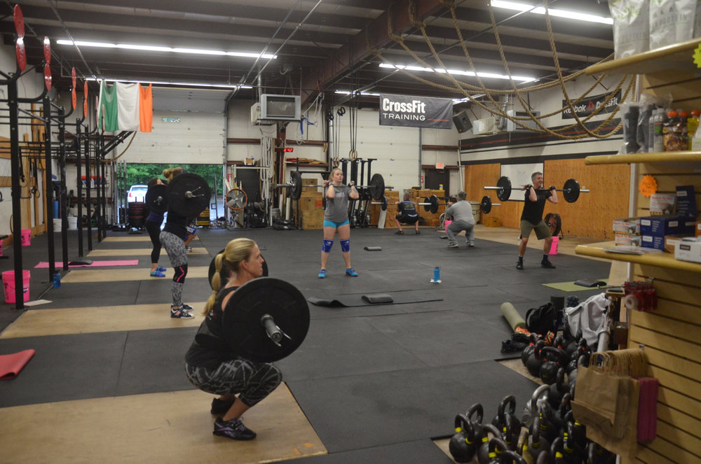 Rosemary and the 6am class starting their day with a whole bunch of front squats.