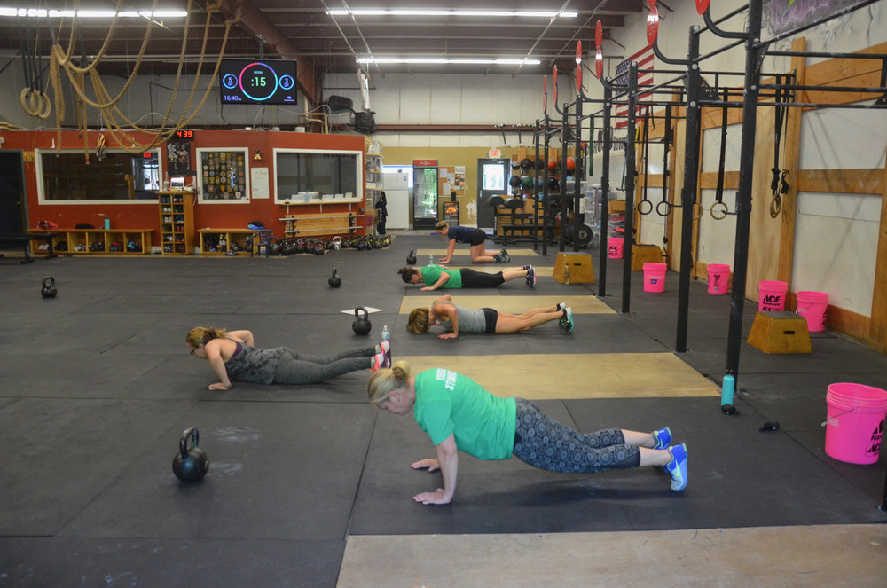 The 4pm class working through their push-ups.