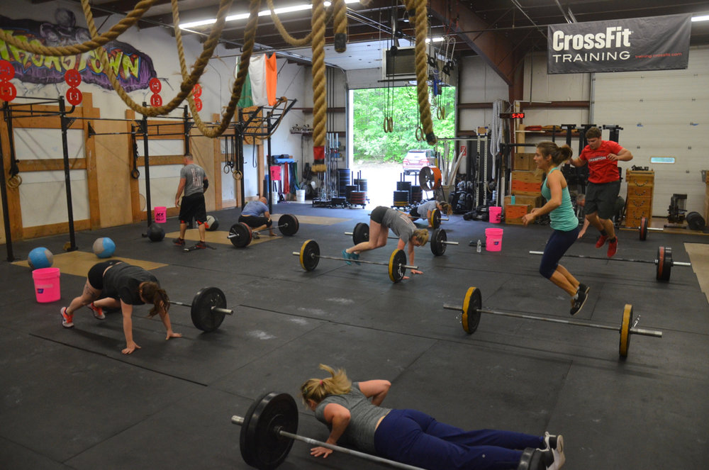 The 5pm class working through their lateral bar burpees.
