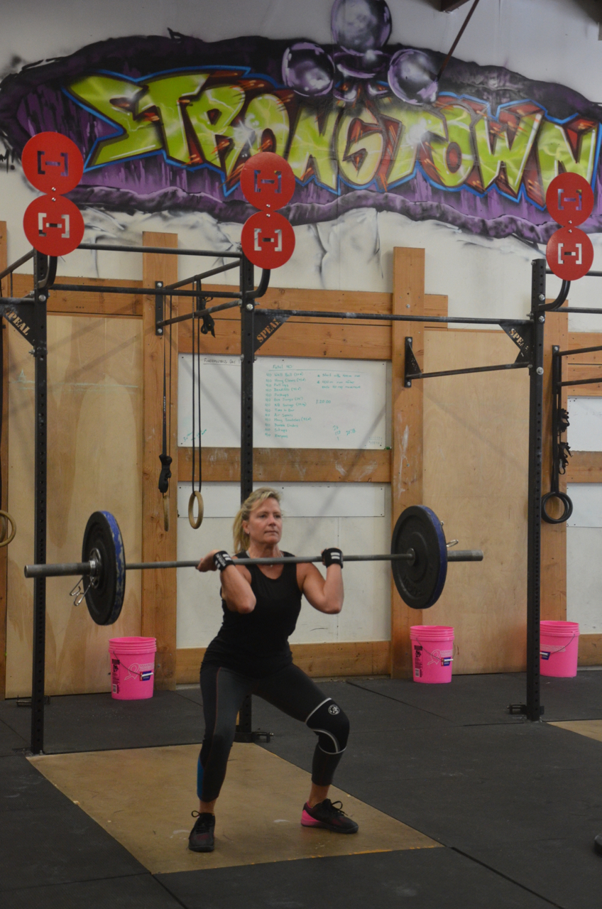 Kristie showing a great receiving position on her hang power cleans.