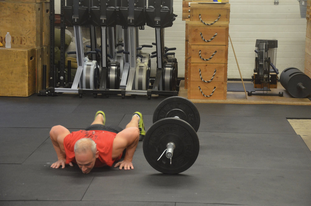 Paul getting his chest to deck in the bottom of his burpees.