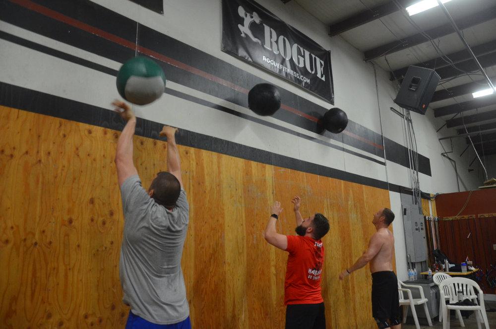 Chris, Matty, and BVN working through their 20 wall ball shots.
