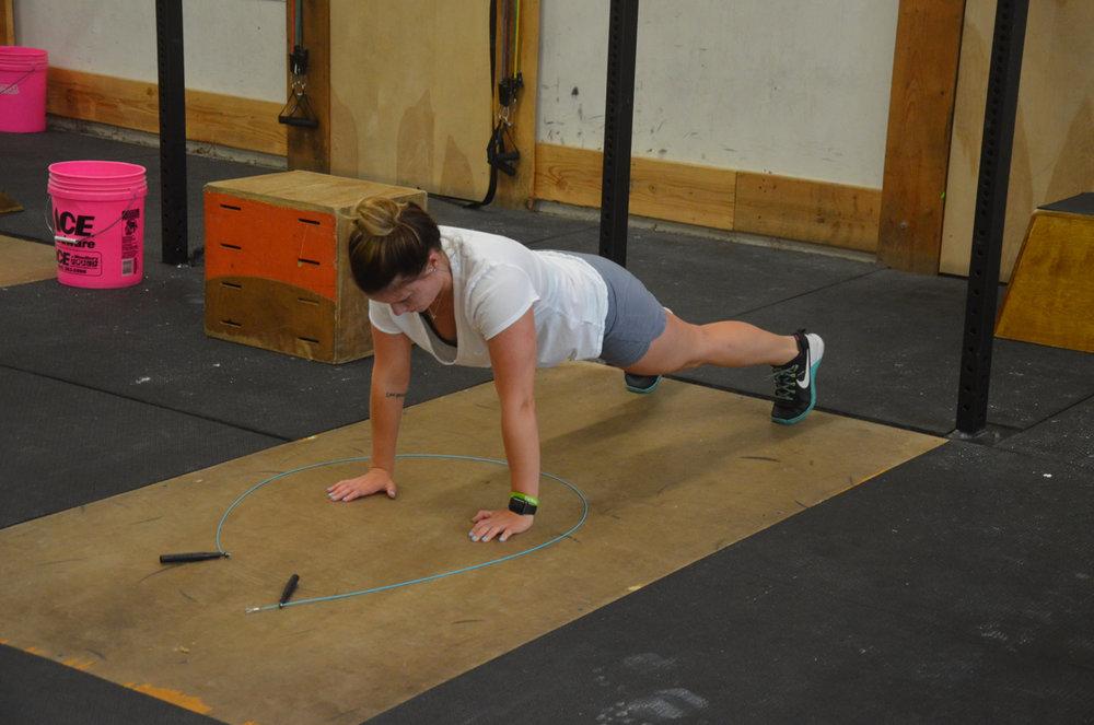 Lu staying strict through her push-ups.