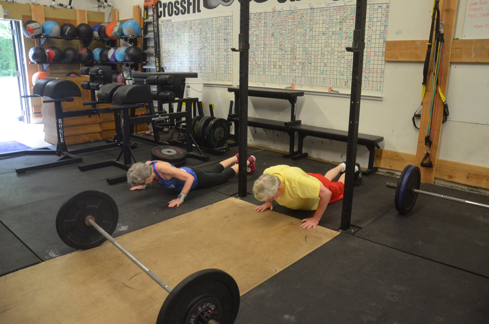 Bernie and GereLu working on their synchronized burpees