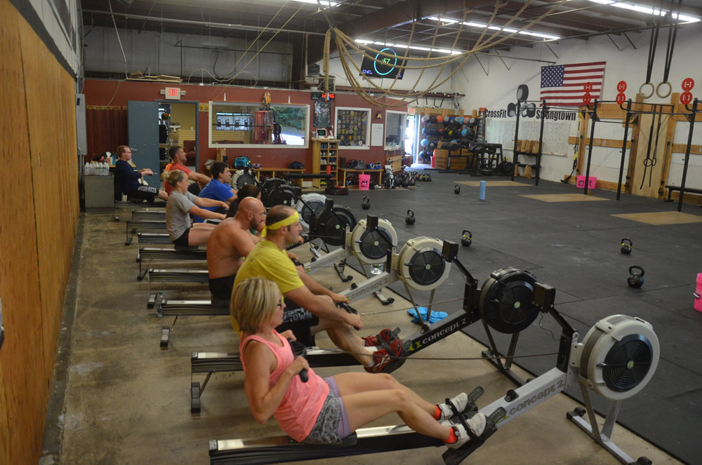The 12:00 class starting their 50 calorie row.