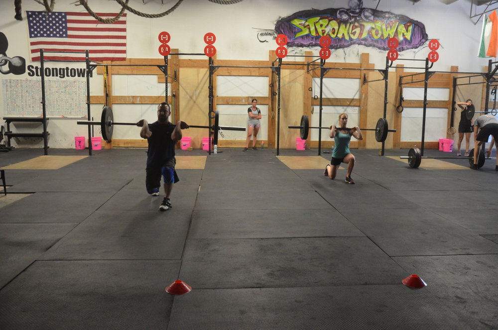 Tommy and Leila during their walking barbell lunge.