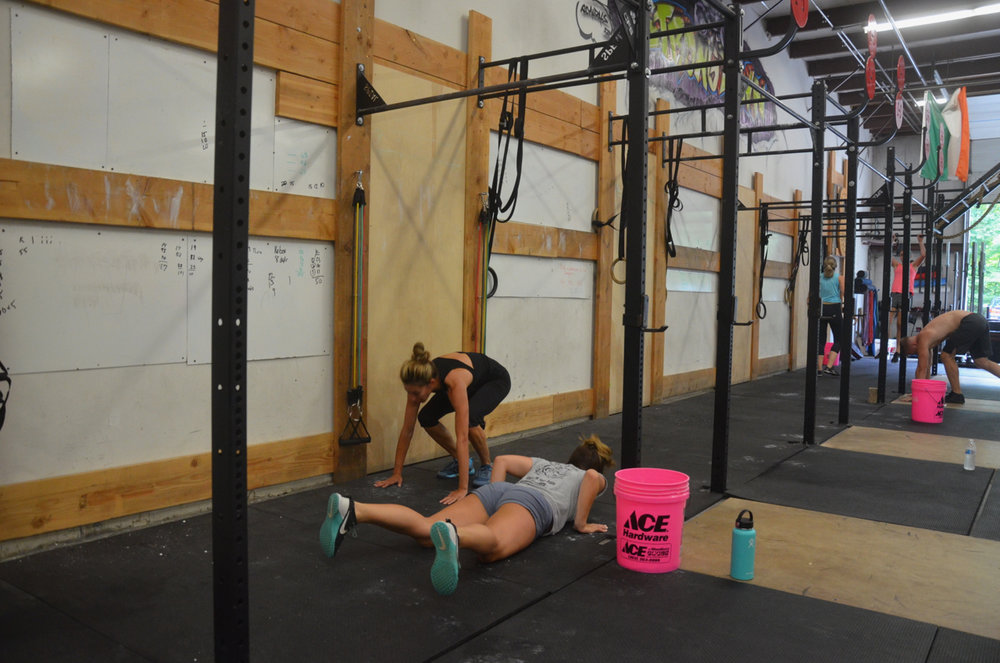 Lu and Danielle working through Saturday's burpee pull-up fiasco.
