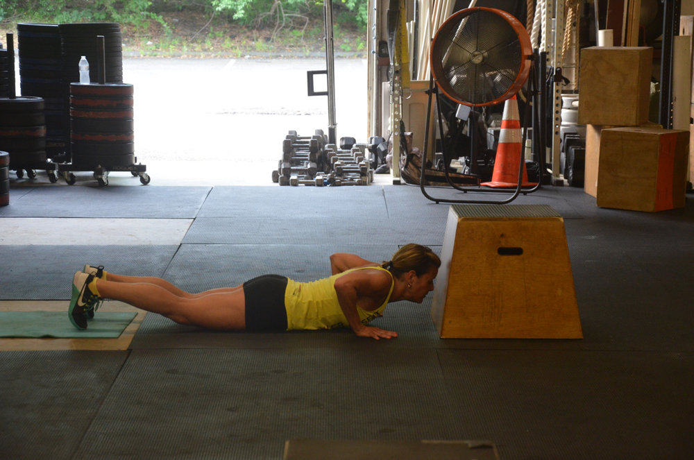 Ang working through her burpee box jumps.