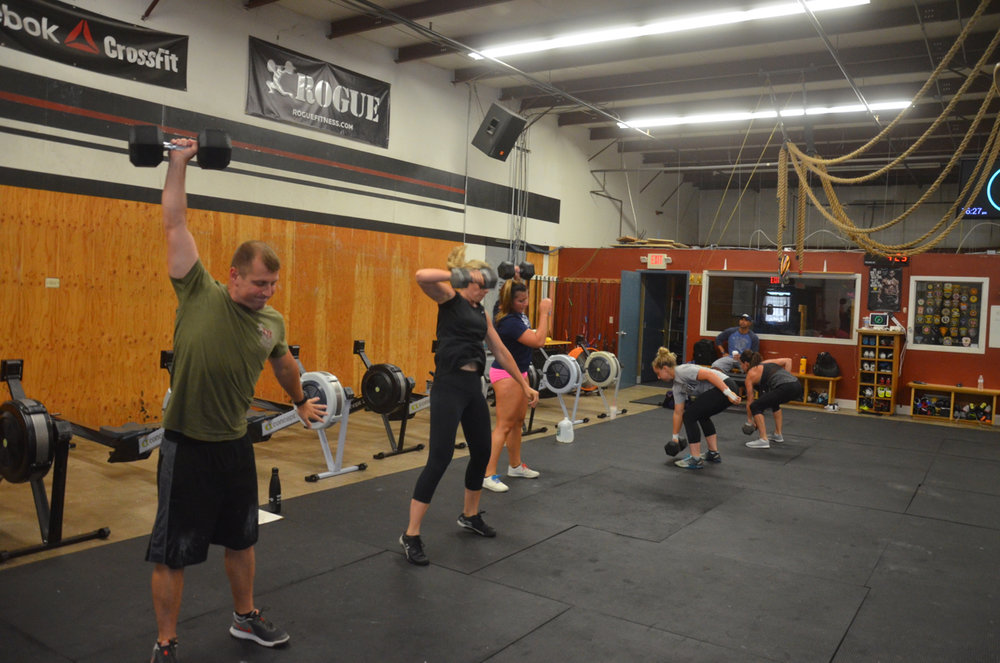Garrett and the 4pm class starting their Dumbbell Snatch & Row .
