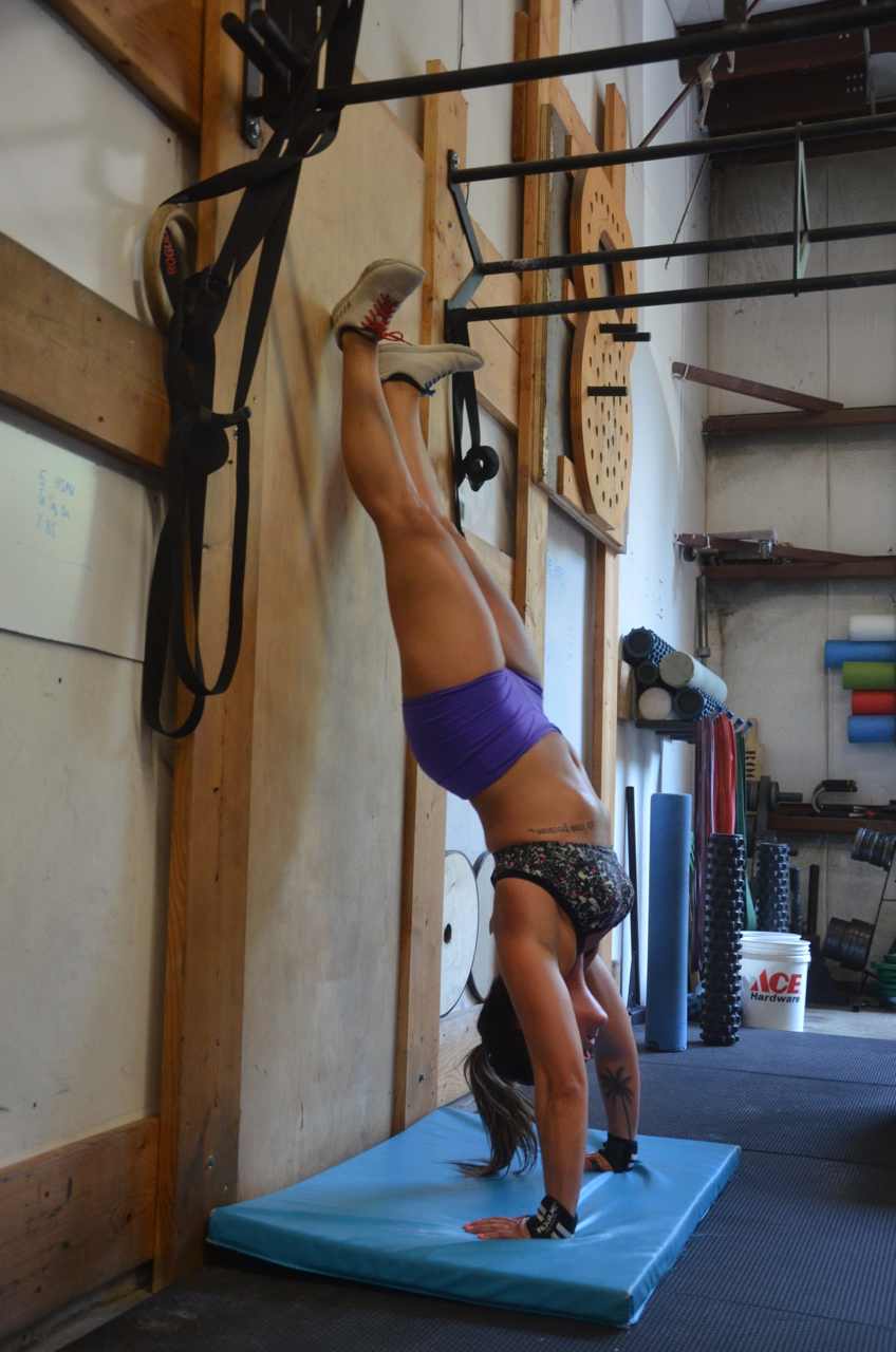Rachie locking out her handstand push-ups.