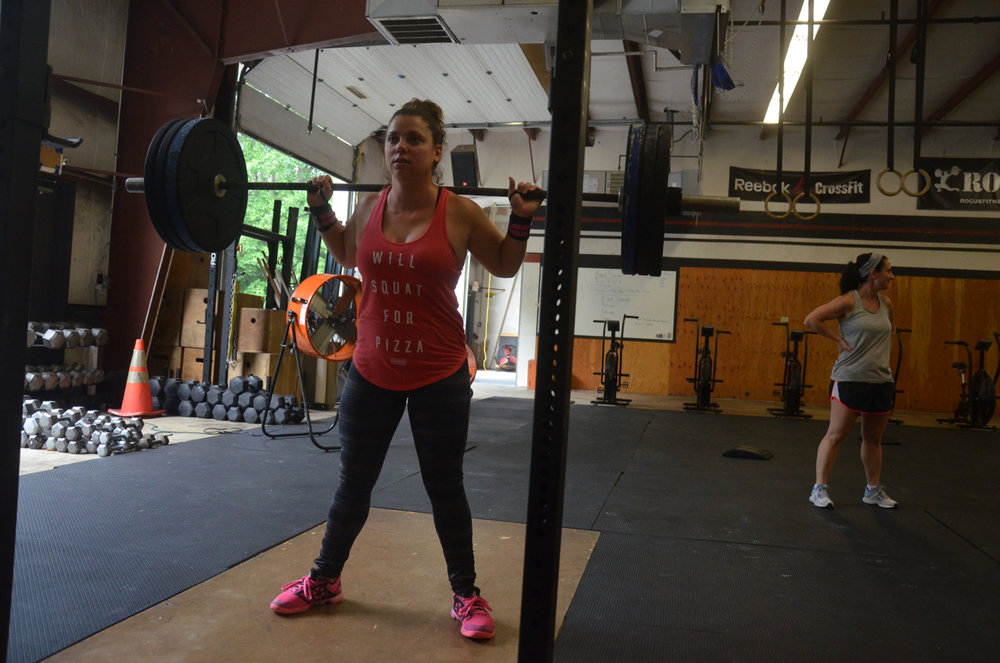 Mrs. War getting set for her squats.