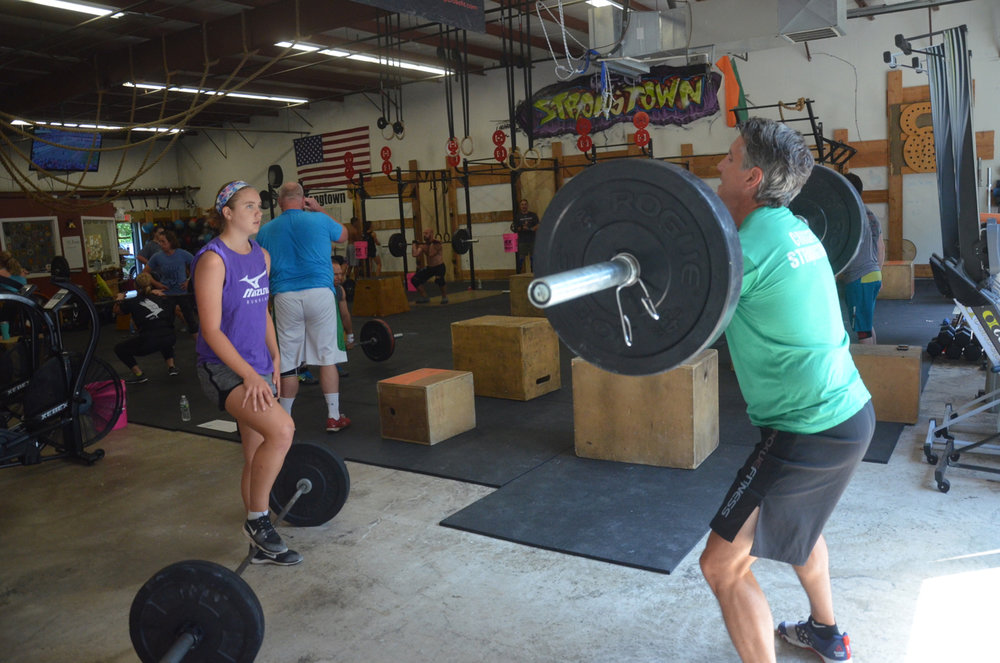 Team Flanagan back from vacation and back under a barbell.