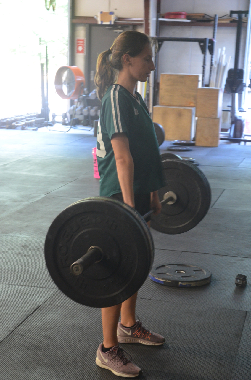 Tess showing a good finish on her deadlifts.