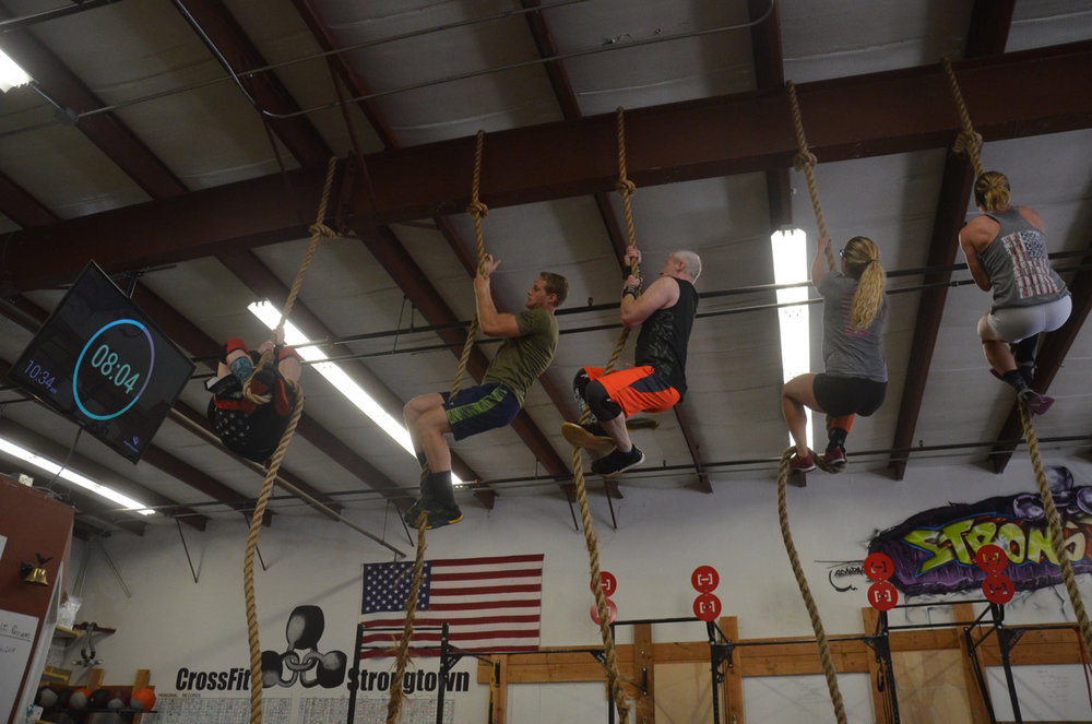 Saturday's 10am heading up their rope climbs.